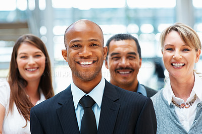 Buy stock photo Group of executives smiling indoors