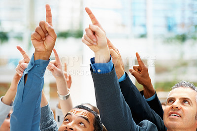 Buy stock photo Group of executives all pointing at something