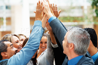 Buy stock photo Group of business people high-fiving one another