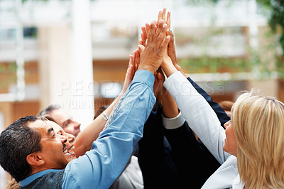 Buy stock photo Executives high-fiving one another