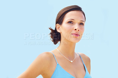 Buy stock photo Portrait of stunning young woman looking away against background of sky