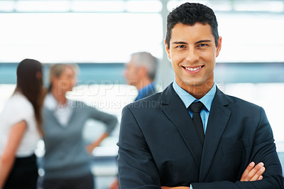 Buy stock photo Closeup view of businessman with colleagues in background