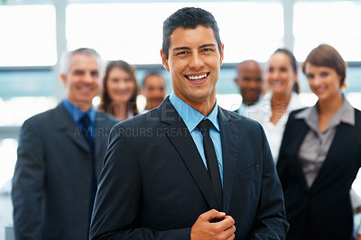 Buy stock photo Confident business man with colleagues in background