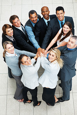 Buy stock photo Top view of colleagues with hands piled on top