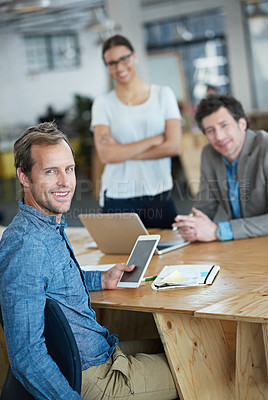 Buy stock photo Portrait of a group of colleagues sitting in an office