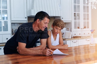 Buy stock photo Cropped shot of a father going over a list of chores with his son at home