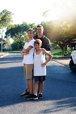 Buy stock photo Portrait of a father standing with his two young sons outside