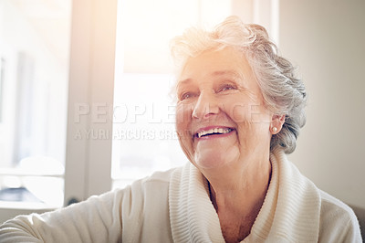 Buy stock photo Cropped shot of a senior woman looking thoughtful at home