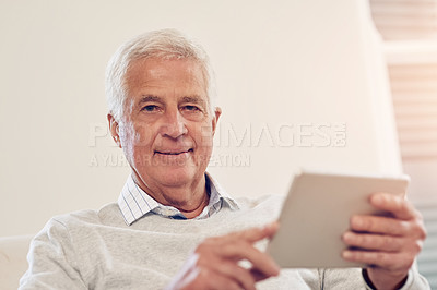 Buy stock photo Portrait of a senior man using a digital tablet at home