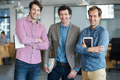 Buy stock photo Portrait of a group of smiling coworkers standing together in an office
