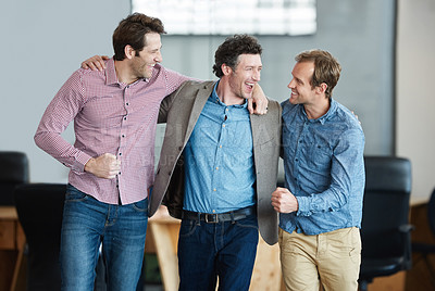 Buy stock photo Shot of a group of laughing coworkers standing arm in arm together in an office