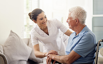 Buy stock photo Shot of a caregiver helping a senior man in a wheelchair at home