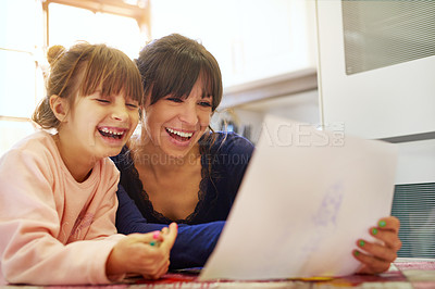 Buy stock photo Cropped shot of a mother and daughter colouring in together at home