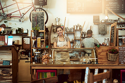 Buy stock photo Portrait of a confident young woman working in a coffee shop