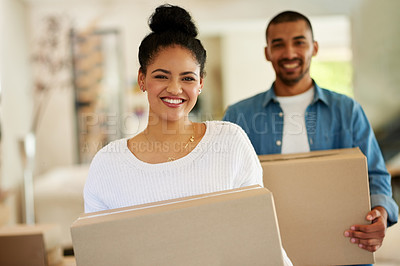 Buy stock photo Portrait of a happy young couple carrying cardboard boxes into their new home