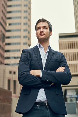 Buy stock photo Cropped shot of a confident young businessman out in the city