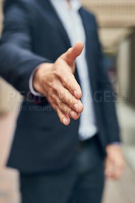 Buy stock photo Closeup shot of an unidentifiable businessman gesturing for a handshake