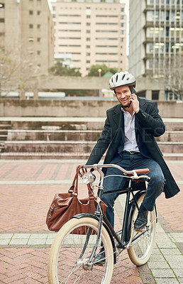 Buy stock photo Portrait of a young businessman commuting to work with his bicycle