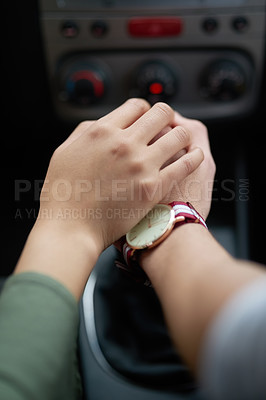 Buy stock photo Closeup shot of a couple holding hands while driving in a car