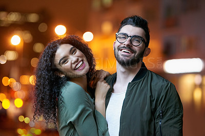Buy stock photo Portrait of a happy young couple outdoors at night