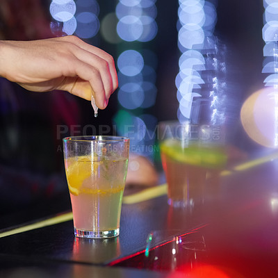 Buy stock photo Closeup shot of a man drungs into a drink in a nightclub