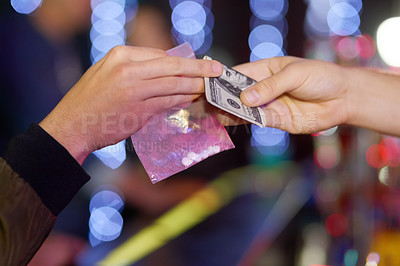Buy stock photo Closeup shot of a woman buying ecstasy from a dealer in a nightclub