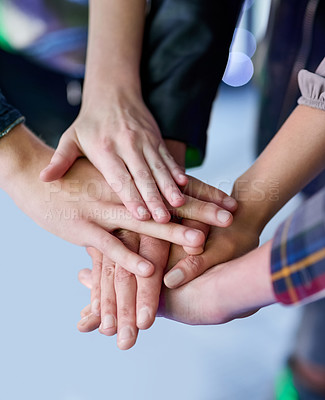 Buy stock photo Shot of a group of unidentifiable friends making a pact by putting their hands in a pile