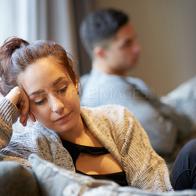 Buy stock photo Shot of a young woman looking despondent after a fight with her boyfriend