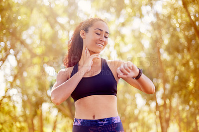 Buy stock photo Shot of a sporty young woman outdoors
