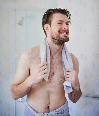 Buy stock photo Cropped shot of a handsome young man wrapped in a towel after a shower