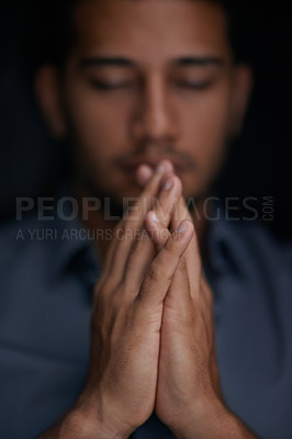 Buy stock photo Cropped shot of a young man holding his hands together in prayer