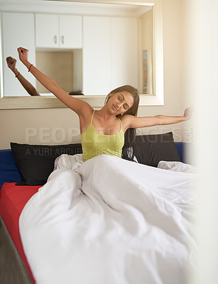 Buy stock photo Shot of a young woman waking up in bed feeling well rested