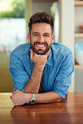 Buy stock photo Portrait of a happy man leaning against a counter at home