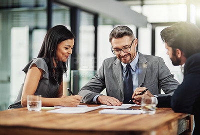 Buy stock photo Shot of corporate coworkers talking in the office
