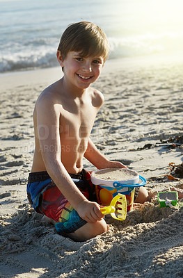 Buy stock photo Portrait of a little boy playing in the sand at the beach