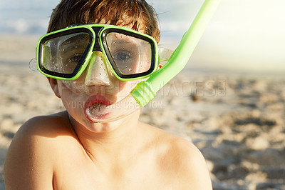 Buy stock photo Portrait of a little boy wearing a mask and snorkel at the beach