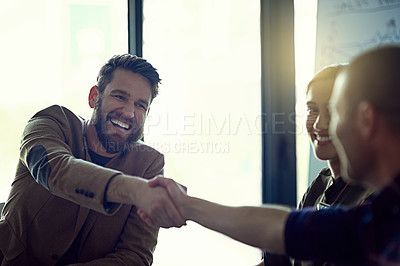 Buy stock photo Cropped shot of two businessmen shaking hands