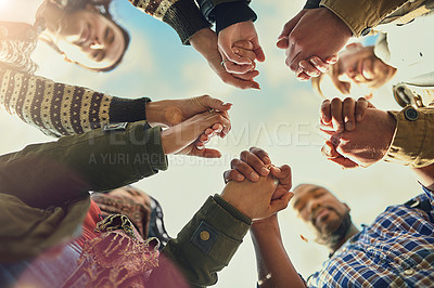 Buy stock photo Shot of a group of friends putting their hands together in prayer