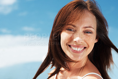 Buy stock photo Portrait of an attractive young woman looking happy - Outdoor