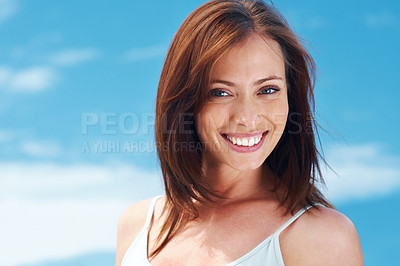 Buy stock photo Portrait of a lovely young woman looking happy against the sky - Outdoor