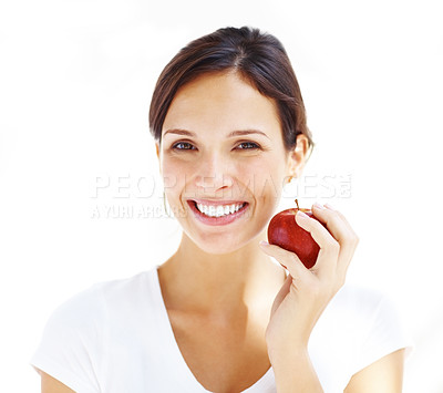 Buy stock photo Portrait of an attractive young woman with an apple ahainst white background