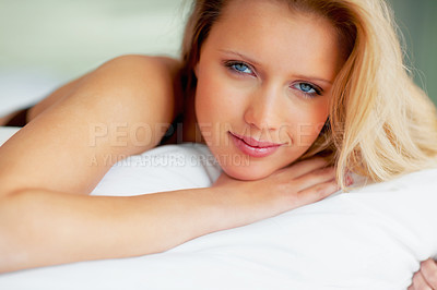 Buy stock photo Attractive blue eyed woman relaxing on bed