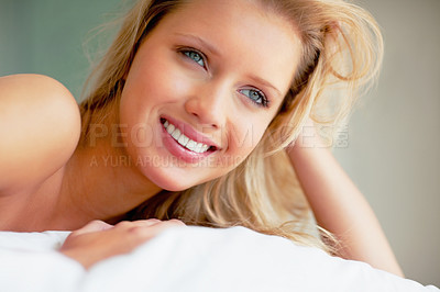 Buy stock photo Beautiful young woman smiling while thinking about something