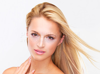 Buy stock photo Portrait of a beautiful blonde woman with flawless skin gazing at you, isolated on white