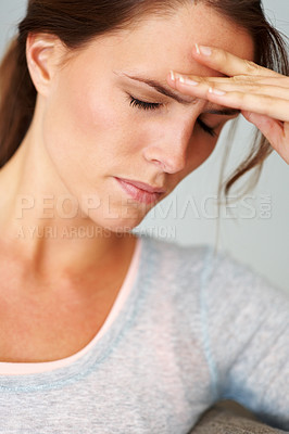 Buy stock photo Closeup of a pretty young woman looking frustrated