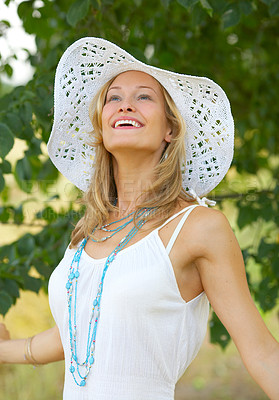 Buy stock photo Flirtatious portrait of a woman with a summer hat - This picture is taken in Denmark in June 2006.