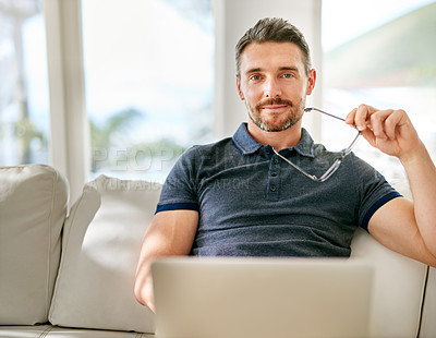 Buy stock photo Shot of a handsome mature man relaxing on the sofa at home