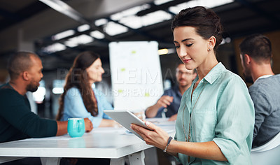 Buy stock photo Shot of businesspeople having a meeting in a modern office