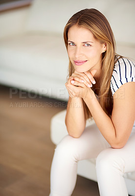 Buy stock photo Shot of a young woman relaxing on the sofa at home