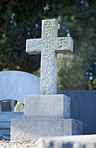 The crucifix is the guardian of this grave